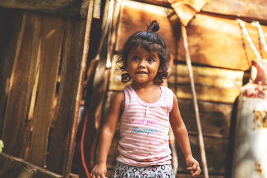 Cute little Mexican girl. Childhood. Portrait of young girl, Mexican ethnicity, outside.