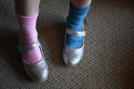 original and nonconformist child with mismatched socks