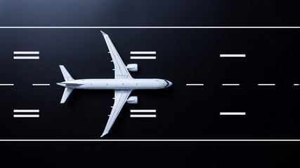 Privat passenger plane fly up over take-off runway from airport on black background. Transport hub