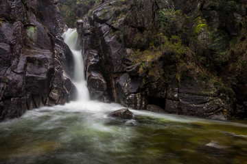 """The """"Arado"""" waterfall in a raining day, UNESCO World Heritage Geres National Park, Portugal."""