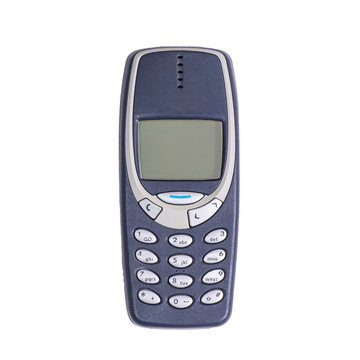 Old mobile phone on a white background. Isolated