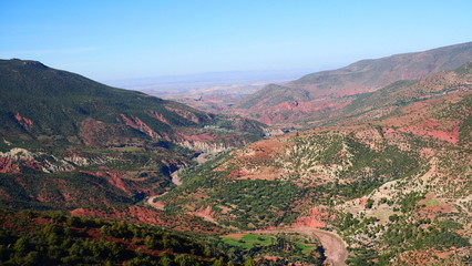Foto op Canvas Khaki Bright landscape of Morocco, breathtaking curves of mountains, stunning combination of hills & farm land,inadvertent distribution of houses & huts, raw impression of pure nature.