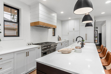 Beautiful white kitchen with dark accents in new modern farmhouse style luxury home Fotobehang