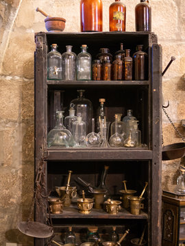 shelf with old and antique bottles