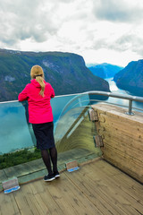 Girl on the Stegastein viewpoint in Norway.