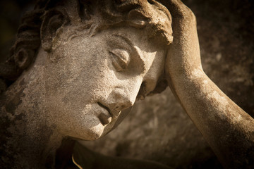Fototapete - Sad eyes of beautiful angel. Close up ancient statue. Death, pain and end of life concept.