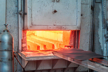 Metal hardening furnace. The door is open, ready to load metal parts.