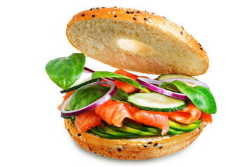 Smoked salmon spinach avocado cucumber bagel on a white isolated background