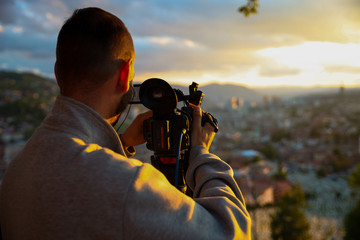 Professional video technician on assignment.Concept.-Waiting for the right moment.-Image