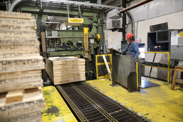 Finished lumber is run through the wrap-and-strap machine at West Fraser Pacific Inland Resources sawmill in Smithers