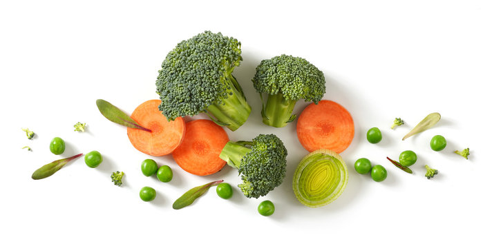 fresh broccoli, carrot and green peas isolated on white background