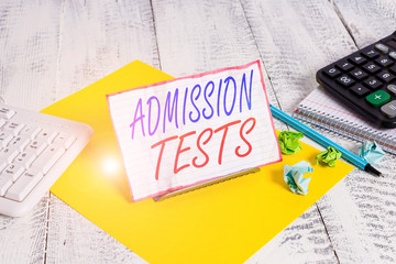Writing note showing Admission Tests. Business concept for an exam that you take to be accepted...