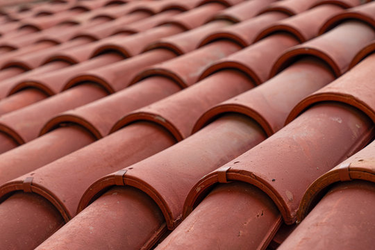 Close-up of an old house roof with a terracotta tiles (clay). Turkey