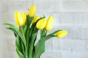 Keuken foto achterwand Tulp Bouquet of yellow tulips in natural light. Spring flowers