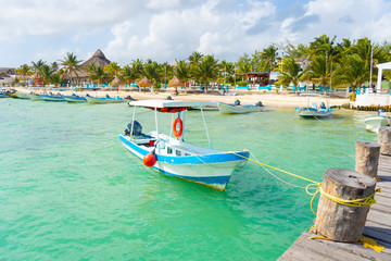 Poster Zanzibar Puerto Morelos seaside view with sea and boats. Caribbean sky with clouds. White sand shore. Background or wallpaper. Yucatan. Quintana roo. Mexico. Riviera maya.