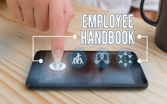 Writing note showing Employee Handbook. Business concept for states the rules and regulations and policies of a company
