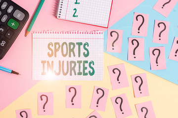 Text sign showing Sports Injuries. Business photo showcasing kinds of injury that occur during sports or exercise Mathematics stuff and writing equipment above pastel colours background