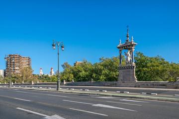 Gothic bridge Pont del Real with the sculpture of Saint Vincent Martir in Valencia, Spain