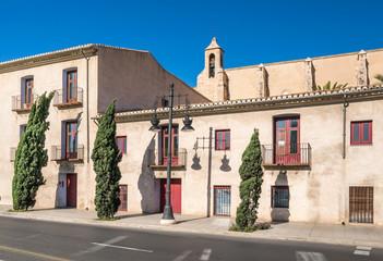 Carrer de la Trinitat with the monastery Real Monasterio de la Santisima Trinidad in Valencia, Spain
