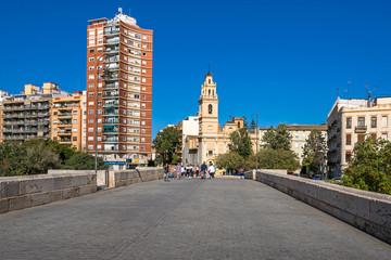 Serranos bridge and the square  Plaza de Santa Monica with Church of Santa Monica in Valencia, Spain