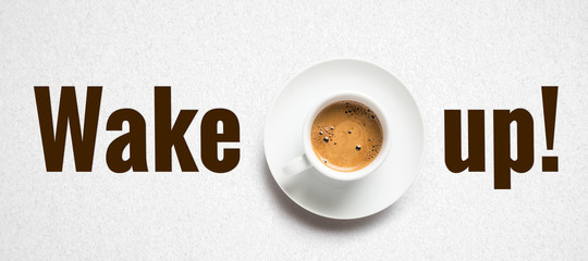 cup of coffee and text WAKE UP! on paper background