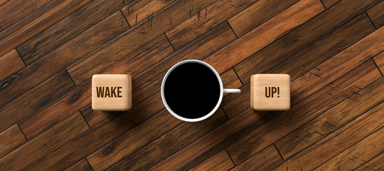 cup of coffee and cubes with text WAKE UP! on wooden background