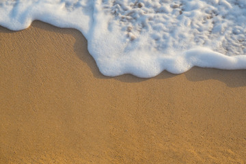 Tropical beach background with soft wave and white foam