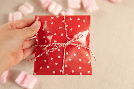 Valentines Gift Wrapped in Red and White Wrapping Paper