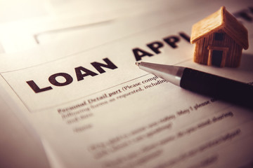 Close up Loan Application form paper with pen , home loan or personal loan application concept