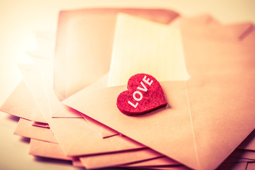close up Stacking of pink envelopes and mail letter paper and the red herat , romance  love letter concept for holiday valentines day greeting card concept