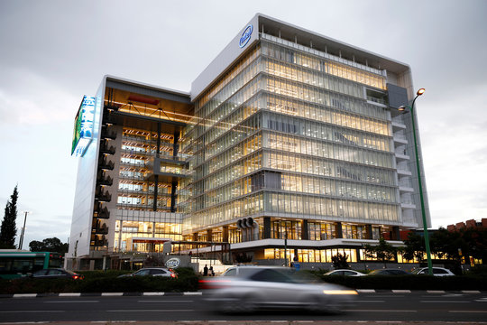 "Cars drive past U.S. chipmaker Intel Corp's ""smart building"" in Petah Tikva, near Tel Aviv"