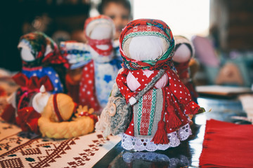 Traditional folk doll amulet made of fabric. Vintage toys for children.