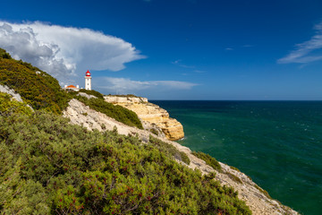 Farol de Alfanzina, a lighthouse near Carvoeiro at the southern coast of the Algarve, Portugal.