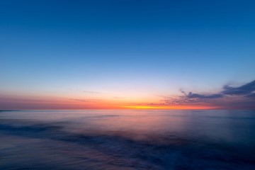 Colourful sky over the north sea after sunset at the beach on Juist, East Frisian Islands, Germany.