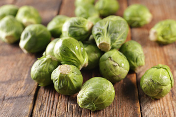Fotobehang - raw brussels sprouts on wood background