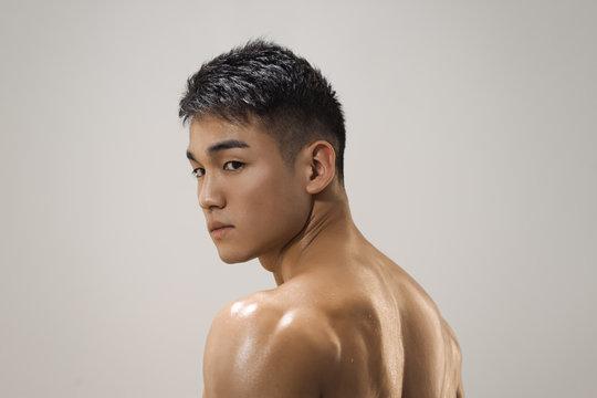 Muscular Asian Man Indoors in th Studio