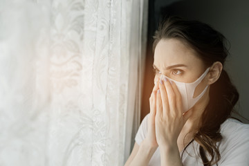 woman afraid of catching a cold, adult wearing dust mask, pm 2.5 dust