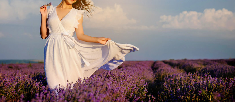 close up photo of a woman in white dress in lavender field
