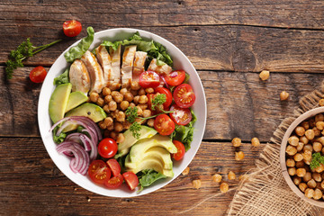 Fotobehang - buddha bowl- vegetable salad with grilled chicken fillet