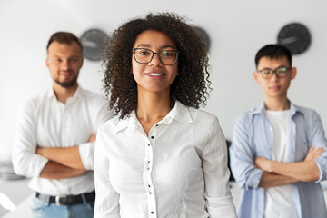 Black woman with multiracial team in office