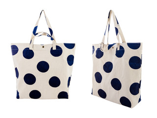 White canvas bag with random navy blue dots pattern isolated on white background.