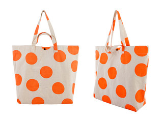 White canvas bag with random orange dots pattern isolated on white background.