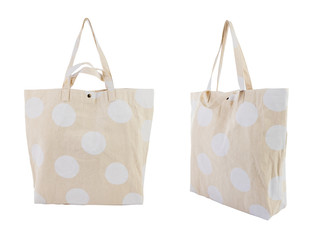 White canvas bag with random white dots pattern isolated on white background.