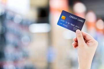 business shopping merchant ideas concept Close up of woman hand holding credit card for shopping...