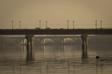 Artistic photo of famous Paton Bridge, one of the bridges across the Dnieper in Kiev, Ukraine. Art sepia.