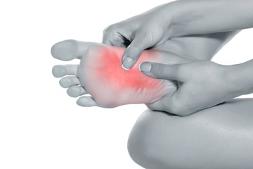 woman massaging her painful foot on white background