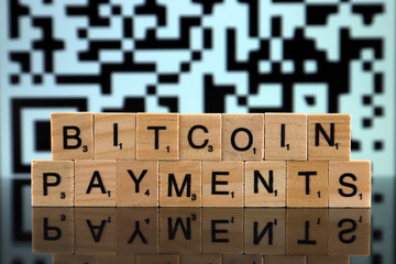 WROCLAW, POLAND - FEBRUARY 04, 2020: Words BITCOIN PAYMENTS made of small wooden letters. Conceptual image for investors settling in bitcoins.