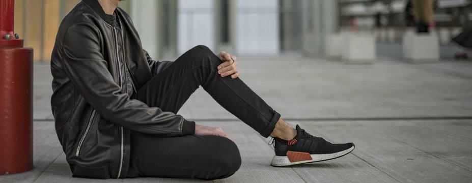 Young man wearing Adidas NMD 2