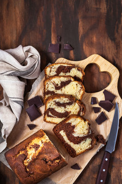 Delicious homemade marble pound cake  on wooden background, top view