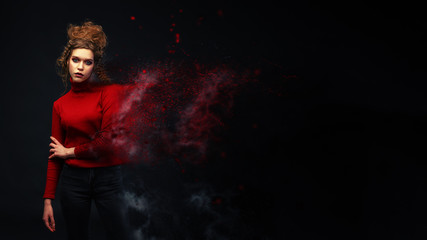 Young Woman In Red Sweater, Creative Effect Particle Decay. Fashion Model Girl Portrait. Stylish hairstyle. Art design. Copy Space